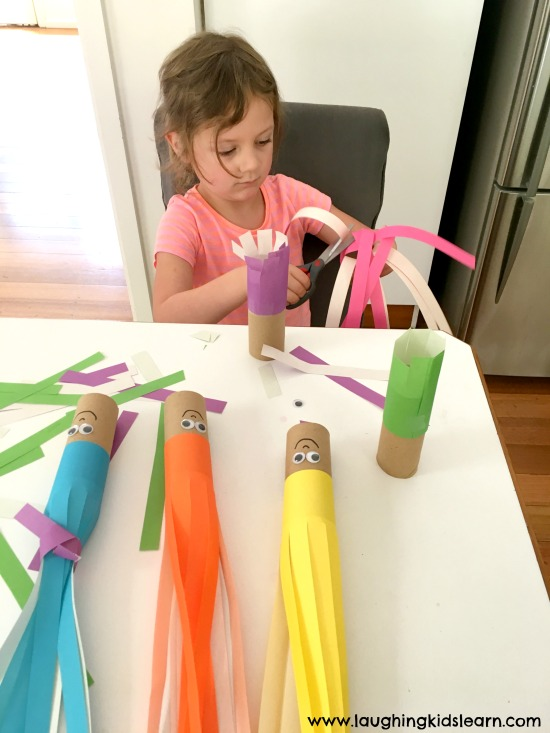 Chop chop. Scissor cutting hair activity that's fun for children of all ages. Great way to develop those fine motor skills.