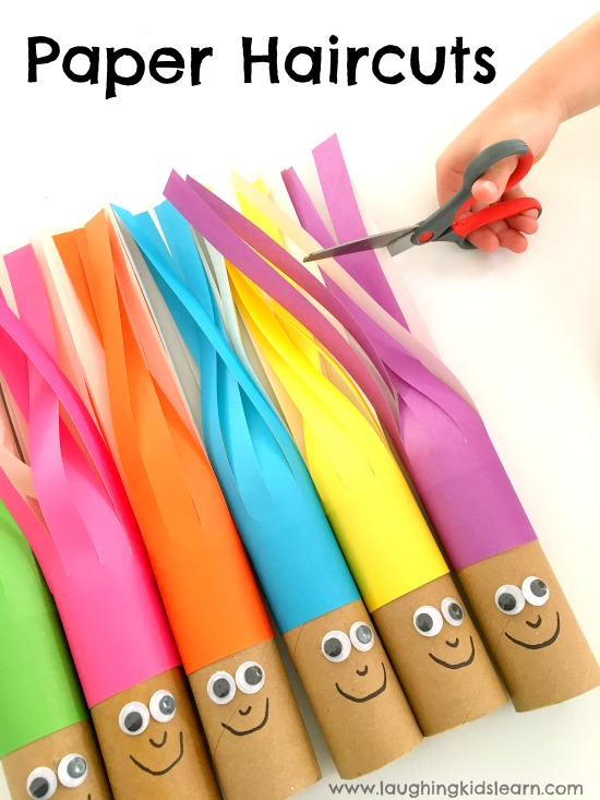 cutting paper hair on cardboard dolls. Scissor cutting hair activity that's fun for children of all ages. Great way to develop those fine motor skills.