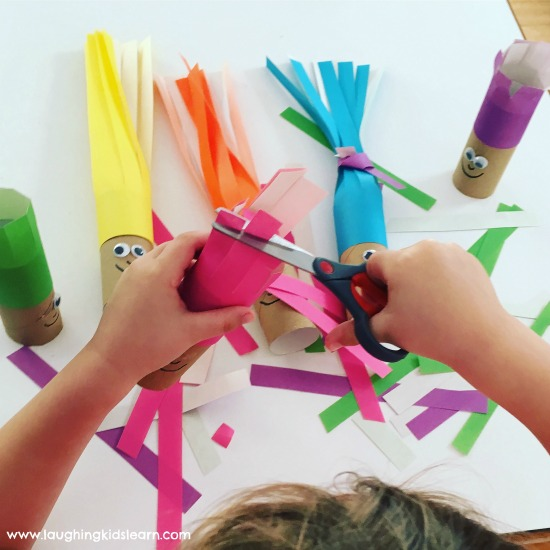 Cutting hair with scissors activity that's fun for children of all ages. Great way to develop those fine motor skills.