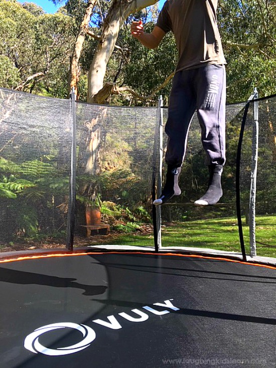 Bouncing on a Vuly trampoline. Lots of fun for the whole family. #vuly #vulytrampoline #trampolineforchristmas #sponsored #gifted #ad #bounce #trampolineideas #funonatrampoline #gamesfortrampoline #christmasideas #familygames #funforthefamily #toddlerplayideas #toddlers #preschoolers #vulyaustralia #australia #funforkids #learnwithplay #funathome