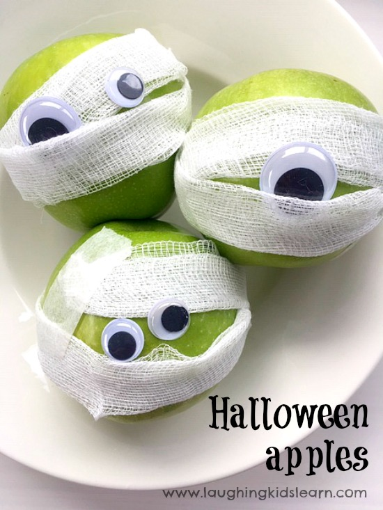 Fun halloween mummy apples are a great fruity treat for children this halloween. So simple to do and healthy. #halloween #halloweenactivities #halloweenfood #halloweenfruit #halloweenideas #greenapples #fruittreat #trickortreat #happyhalloween #preschool #funforkids #diyhalloween #halloweencrafts #halloweencraftideas #easyhalloween #easyhalloweenideas