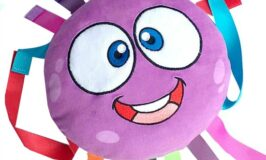 Octi the plush octopus toy for developing find motor skills and more.