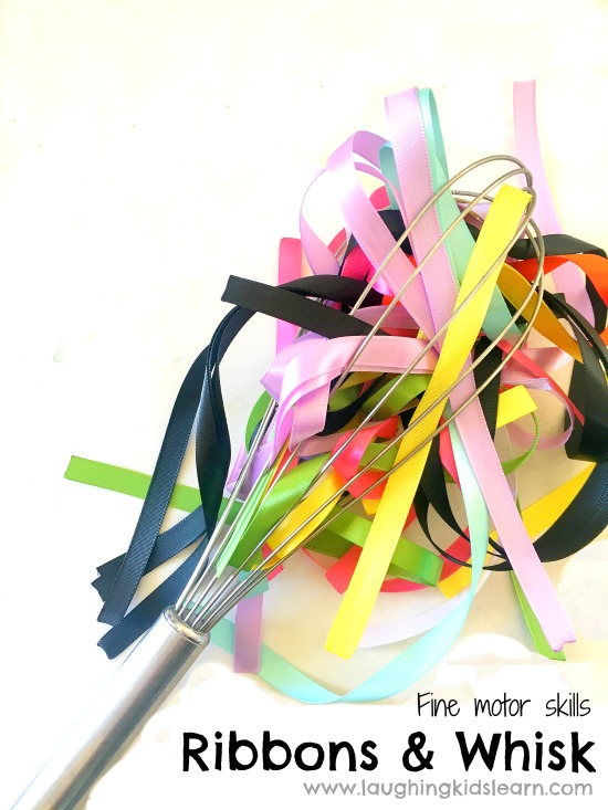 Alterntaive to pompoms and a whisk is this activity for toddlers and preschoolers that is a ribbons and whisk activity for children. Ribbon and whisk fine motor activity for kids is fun and great. #finemotor #finemotorskills #ribbons #lovetoplay #simpleplayideasforkids #indooractivities #babyplay #babyplayideas #homeschooling #homeschool #lovetolearn #preschool #playgroup #playtime #mothersgroup