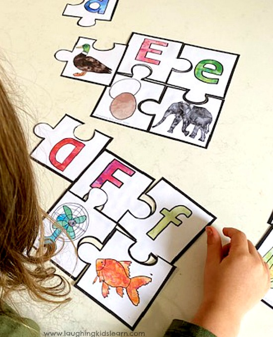 gorgeous alphabet puzzle with beginning sounds for students and children to do. Learn with play. four piece puzzle.