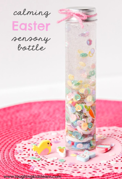 Calming sensory bottle with an easter theme for children to make and play with. Makes great alternative to chocolate. #chocolatealternative #eastertheme #easterthemed #sensorybottles #sensorybottle #sensorydisorder #calmingbottles