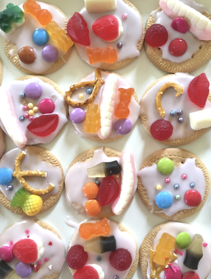 kids decorating iced biscuits is a simple and fun cooking activity to do in school holidays or stuck indoors. #kidscook #icingbiscuits #simplecooking #kidsinthekitchen #mariebiscuits #arnotbiscuits