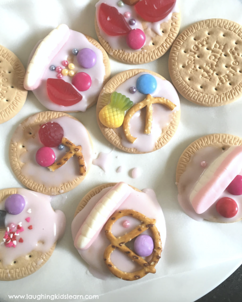 kids decorating iced biscuits is a simple and fun cooking activity to do in school holidays or stuck indoors. #kidscook #icingbiscuits #simplecooking #arnots #mariebiscuits #