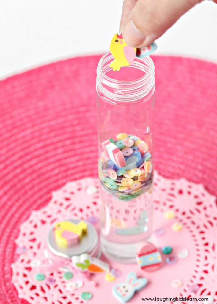 adding sequins and erasers to sensory bottles for children #easter #chocolatealternative #erasers
