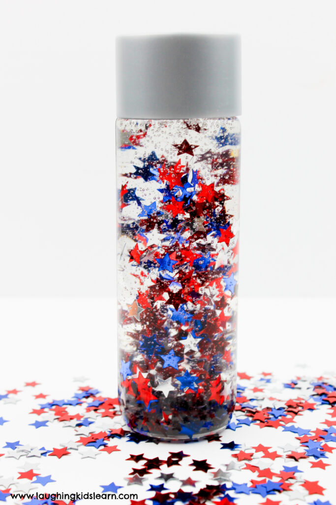 Australia Day sensory bottle. Patriotic sensory bottle for fourth of july, presidents day, memorial day and more. Simple sensory bottle to make at home. Great for calming children. #sensorybottle #sensorybottles #patriotic #4thjulycraft #4thjuly #redwhiteandblue #redwhiteblue #usacraft #usasensorybottle #godblessamerica #fourthjuly #presidentsdayactivities #memorialdayactivities #usaactivities #sensorydevelopment #calmdownbottles #calmdown #selfregulate #lovetolearn #funathome #australiaday
