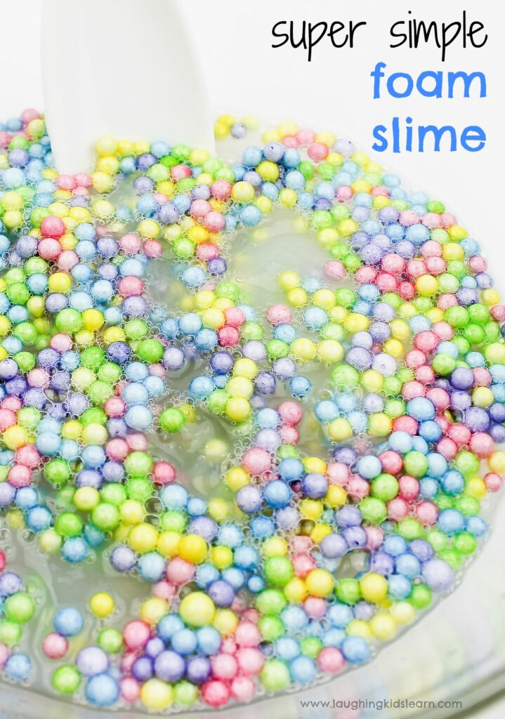 Super simple slime recipe with foam balls is great for sensory play. Learn how to make it. #slime #sensoryslime #foamslime #slimerecipe #kidsscience #simpleslime #glueslime #elmerglue #makingslime #makeslime #recipeforslime #funslime #texturedslime #sensoryplay #sensoryprocessing #rainbowcolors #rainbowslime colorfulslime #easyslimerecipe #funslime #makeslime #styrofoamballs #stretchyslime #kbn #floam #funtomakeslime #threeingredients #simplerecipeforkids #kidsplay #messyplay #pastelcolors