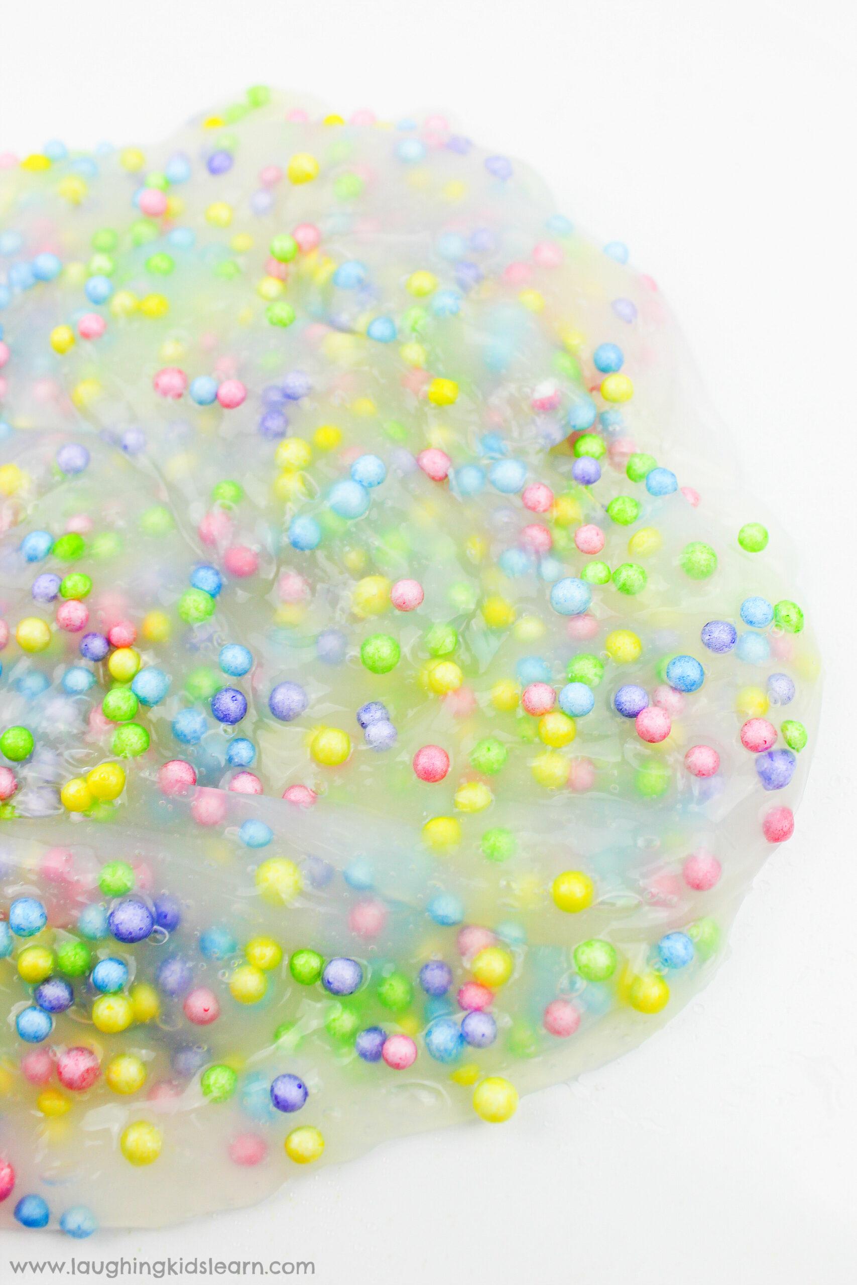 simple slime recipe with foam balls is great for sensory play. Learn how to make it. #slime #sensoryslime #foamslime #slimerecipe #kidsscience #simpleslime #glueslime #elmerglue #makingslime #makeslime #recipeforslime #funslime #texturedslime #sensoryplay #sensoryprocessing #rainbowcolors #rainbowslime colorfulslime #easyslimerecipe #funslime #makeslime #styrofoamballs #stretchyslime #kbn #floam #funtomakeslime #threeingredients #simplerecipeforkids #kidsplay #messyplay #pastelcolors