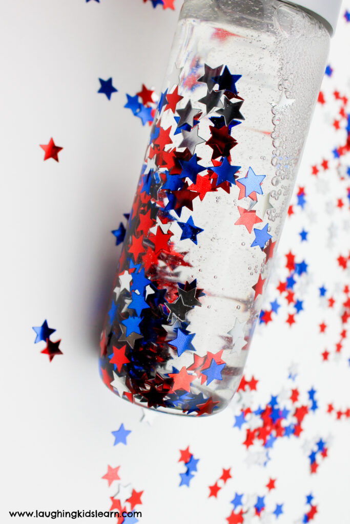 Sensory bottle. Patriotic sensory bottle for fourth of july, presidents day, memorial day and more. Simple sensory bottle to make at home. Great for calming children. #sensorybottle #sensorybottles #patriotic #4thjulycraft #4thjuly #redwhiteandblue #redwhiteblue #usacraft #usasensorybottle #godblessamerica #fourthjuly #presidentsdayactivities #memorialdayactivities #usaactivities #sensorydevelopment #calmdownbottles #calmdown #selfregulate #lovetolearn #funathome #australiaday