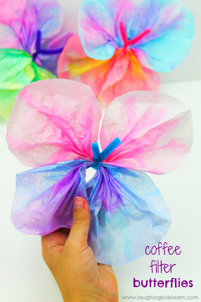 Simple and fun coffee filter butterfly craft for kids to try at home or school. This step by step guide will help you learn how to make coffee filter butterflies. #coffeefilter #coffeefiltercrafts #coffeefilterbutterflies #coffeefilterbutterflycrafts #pipecleaners #finemotor #finemotorskills #craftideasforkids #kbn #simplecraftideas #simplecraft #butterflies #butterflies #papercraft #waterpaints #waterpaintingwithkids #makeabutterfly #butterflycrafts #butterflycraftideas #rainforestcraft