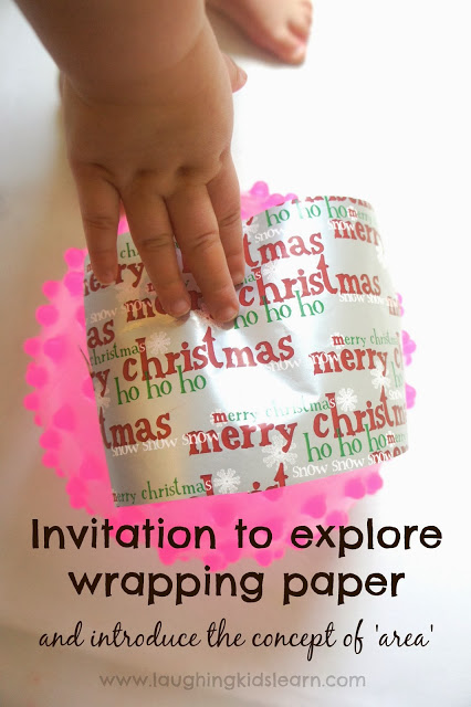 Invitation to explore Christmas wrapping paper and introduce the concept of area to kids