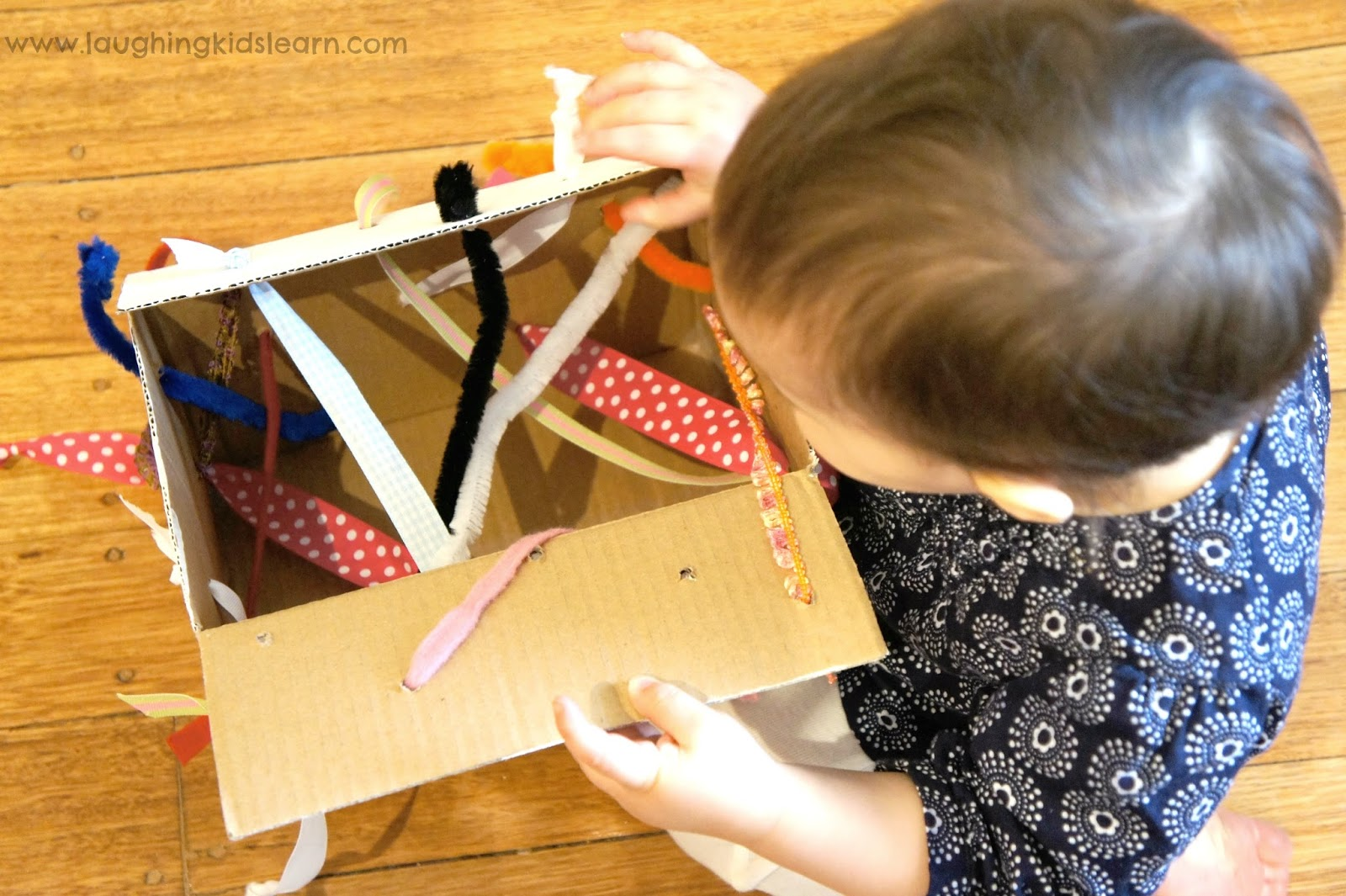 Diy Tugging Box For Fine Motor Development Laughing Kids
