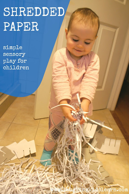 Shredded paper makes a great sensory experience for toddlers