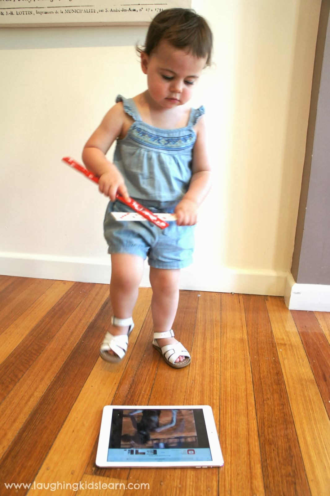 Dancing and playing with homemade Aboriginal clapping sticks for Australia Day