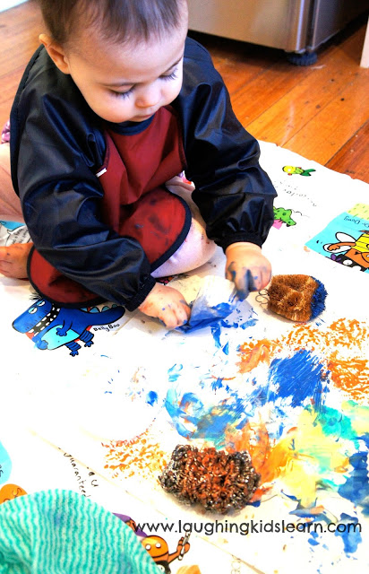 Printing and painting with kitchen cleaners. Great sensory activity for children.